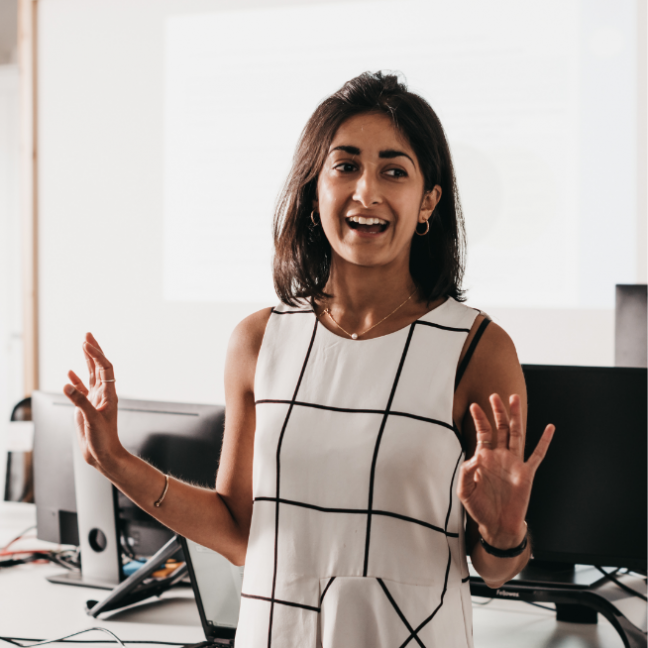woman conducting presentation in an office
